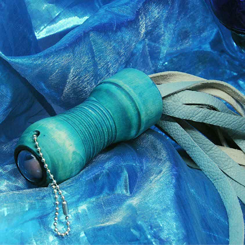 Aqua flogger blue background